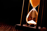 Newly turned hourglass with running sand — Stock Photo