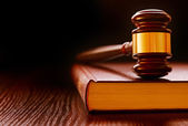 Wood and brass judges gavel on a law book — Stock Photo