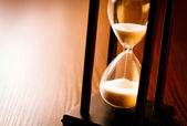Hourglass with the sand running through — Stock Photo