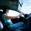 Beautiful young woman driving a car — Stock Photo #48806123