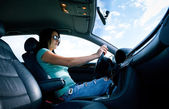 Beautiful young woman driving a car — Stock Photo