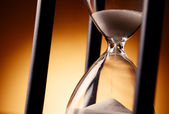 Sand running through an egg timer or hourglass — Stock Photo