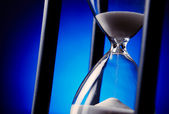 Egg timer with sand running through — Stock Photo