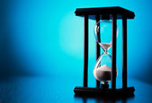 Egg timer or hourglass on a blue background — Stock Photo