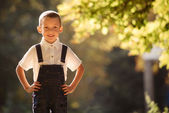 Cute smiling young boy backlit by the sun — Stock Photo