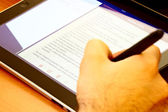 Writing in a Tablet — Stock Photo