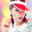 Retro girl in red sun visor - Stock Photo