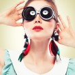Retro girl in round sunglasses - Stock Photo
