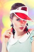 Retro girl in red sun visor — Stock Photo
