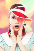 Surprised girl in red sun visor — Stock Photo