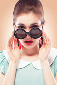Surprised girl in round sunglasses — Stock Photo