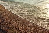 Surf on pebble beach — Foto Stock