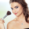 Woman with a make-up brush — Stock Photo #13370635