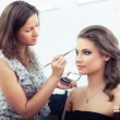 Applying eyebrow make-up — Stock Photo