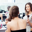 Make-up artist and model — Stock Photo