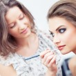 Applying lipstick with a brush — Stock Photo #13370824
