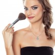 Woman with a make-up brush — Stock Photo #13370867