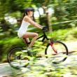 Stock Photo: Girl cycling