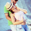 Sexy couple loving on the rocky coast — Stock Photo