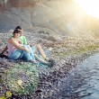 Young couple sitting on the beach — Stock Photo