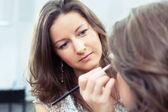 MUA applying make-up — Stock Photo