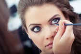 Applying liquid eyeliner — Stock Photo