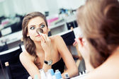 Woman joking in front of a mirror — Stock Photo
