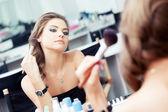 Woman applying rouge — Stock Photo