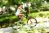 Girl cycling — Stock Photo