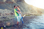 Passionate couple kissing on the beach — Stock Photo