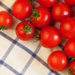 Tomatoes on towel — Stock Photo #14164997