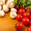 Tomatoes, champignons and rucola - Stock Photo