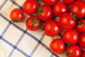 Tomatoes on towel — Stock Photo