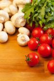Tomatoes, champignons and rucola — Stock Photo