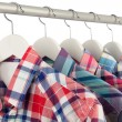 Shirts on hangers — Stock Photo #15521931