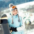 Stock Photo: Young beautiful woman with snowboard