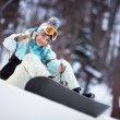 Beautiful young woman with Snowboard showing thumbs up — Stock Photo #15523445