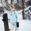 Young female snowboarder — Stock Photo #15523613