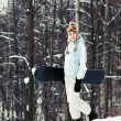 Young woman with snowboard on ski slope — Foto de Stock