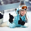 Female snowboarder showing thumbs up — Stock Photo #15523801