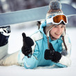 Stock Photo: Female snowboarder showing thumbs up