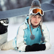 Stock Photo: Young female snowboarder resting
