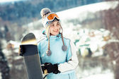 Young beautiful woman with snowboard — Stock Photo