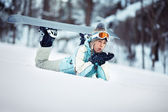 Female snowboarder blowing snow — Stock Photo