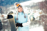 Girl holding snowboard — Stock Photo