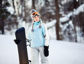 Young female snowboarder — Stock Photo
