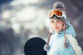 Pretty female snowboarder — Stock Photo