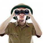 Explorer looking through binoculars — Stock Photo
