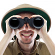 Happy explorer looking through binoculars - Stock Photo