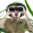Stock Photo: Explorer looking through binoculars
